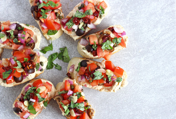 Bruschetta and Hummus on Toasted Baguette Slices