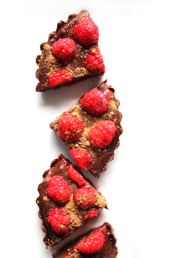 These deliciously sinful, No Bake Chocolate Raspberry Tarts are filled with sweet vegan chocolate and topped with summers brightest berries. A dessert whipped up in minutes and eaten in seconds. NeuroticMommy.com #vegan #chocolate #nobake