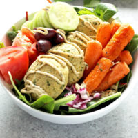 Mediterranean Infused Bliss Bowls - Delectable bowls loaded with falafel, leafy greens, roasted carrots, red onion, tomato, kalamata olives, and cucumbers. Perfectly filling, perfectly healthy. NeuroticMommy.com #vegan #healthy