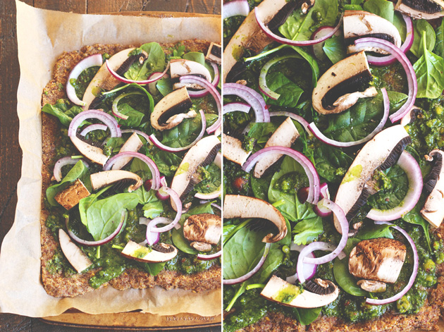 This pizza will hit the spot, it's satisfying, with the right amount of pesto and flavor. Jam packed with nutrients and one of many meals to share with the family after holidays full of sweets. NeuroticMommy.com #vegan #raw #healthy #pizza