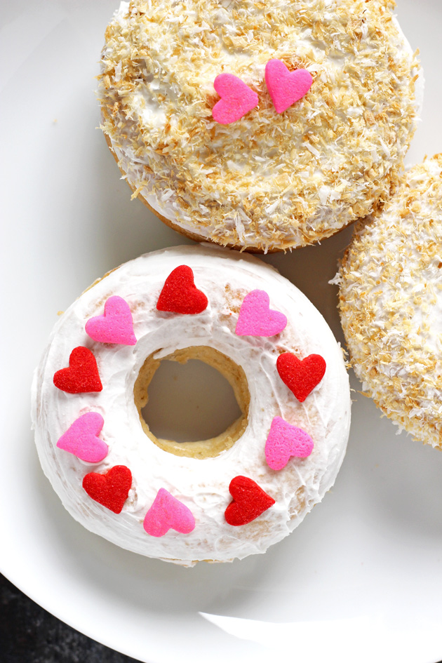 Valentine's Day Toasted Coconut Doughnuts - Fluffy cream filled doughnuts topped with toasted coconut shreds and loving hearts. Perfect for Valentine's Day! NeuroticMommy.com #vegan #donuts #valentinesday