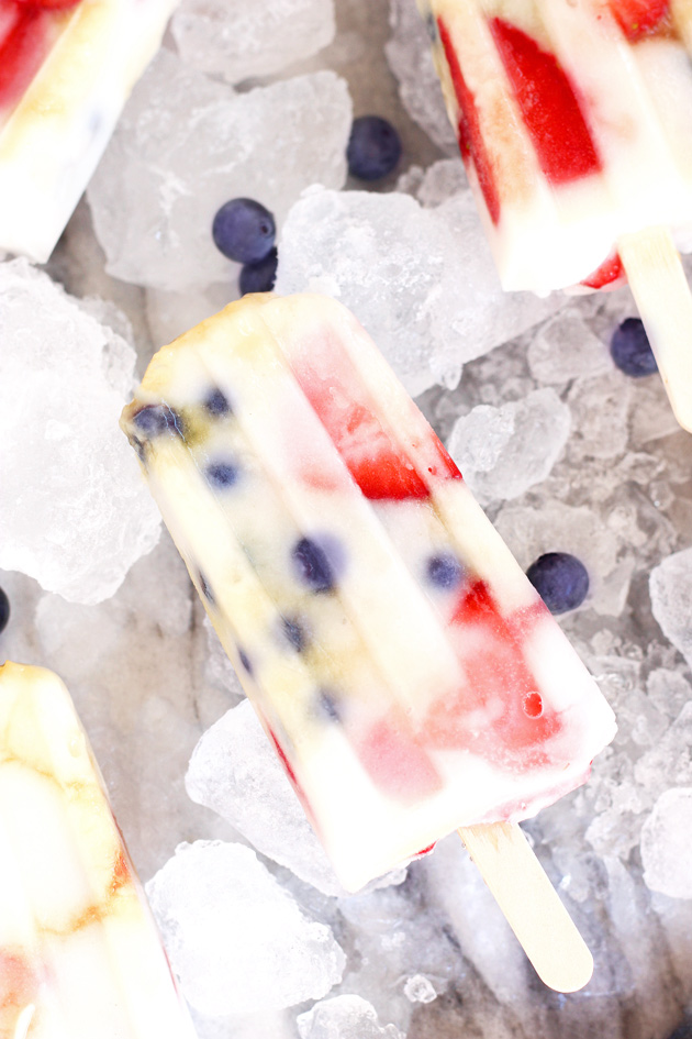 Fruit Fun Yogurt Ice Pops - Cool down with these fresh strawberry blueberry creamy yogurt ice pops that your whole family will LOVE! They're the perfect dairy-free frozen treat on the hottest of summer days. NeuroticMommy.com #healthy #vegan #summer #snacks