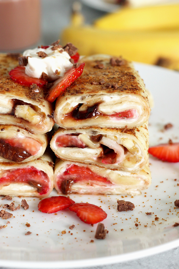 Stuffed Tortilla Cheesecake French Toast - This is the best breakfast, dessert, snack, ever! Stuffed with healthy dark chocolate, strawberries, bananas, and vegan cream cheese, you legit can't go wrong. NeuroticMommy.com #vegan #brunch #healthy