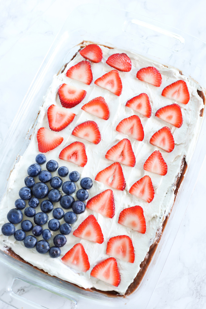 American Flag Chocolate Pudding Poke Cake - A festive fun way to decorate your cakes this summer. Made with all vegan ingredients and coconut whip cream, you cannot go wrong. NeuroticMommy.com #vegan #cake #chocolate