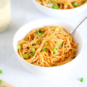 Spicy Vegan Sesame Noodles - An easy to make weeknight dinner made with a pasta or noodle of choice and some easy to put together spices. Can be made non spicy for less hotness. NeuroticMommy.com #veganrecipes #sesamenoodles #easydinners