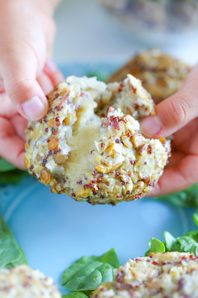 Vegan Mozzarella Stuffed Rice Balls with Lentils and Red Quinoa - A high protein plant based snack or meal you can eat alone or a top of a salad or even paired with pasta. Super cheesy and delicious. NeuroticMommy.com #plantbasedprotein #snacks #veganriceballs