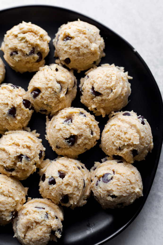 Vegan Cookie Dough Cheesecake Bites - If your a cookie dough and cheesecake lover then these are the bites for you! Made with sugar free dark chocolate chips, sweetened with monk fruit, making this low carb snack a must have. NeuroticMommy.com #vegan #fatbomb #keto #snacks