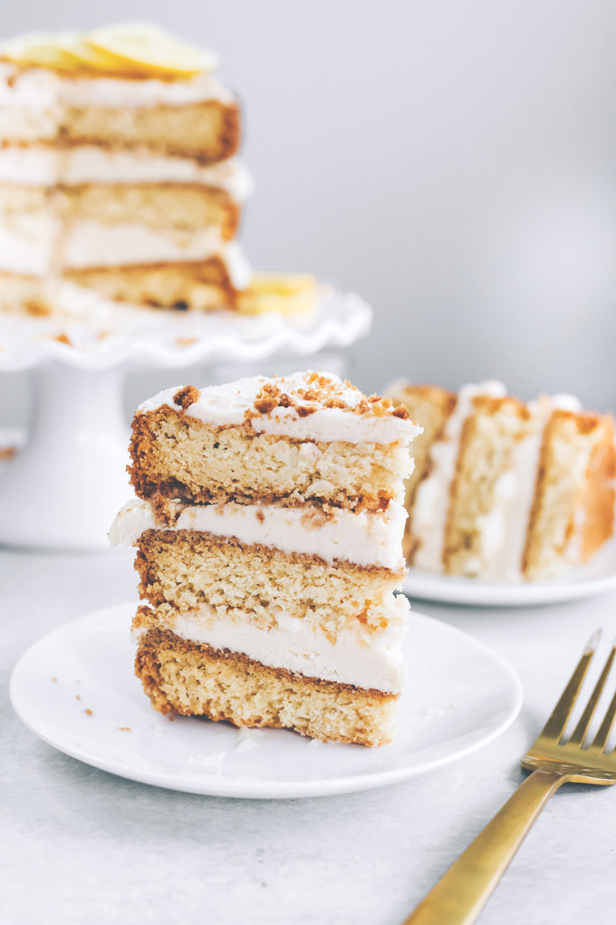 This spectacular Vegan Lemon Cream Layer Cake is a delectable cake for the most special of occasions. Enjoy the creamy lemon buttercream sandwiched between layers of homemade vanilla cake. NeuroticMommy.com #vegan #cake #easter