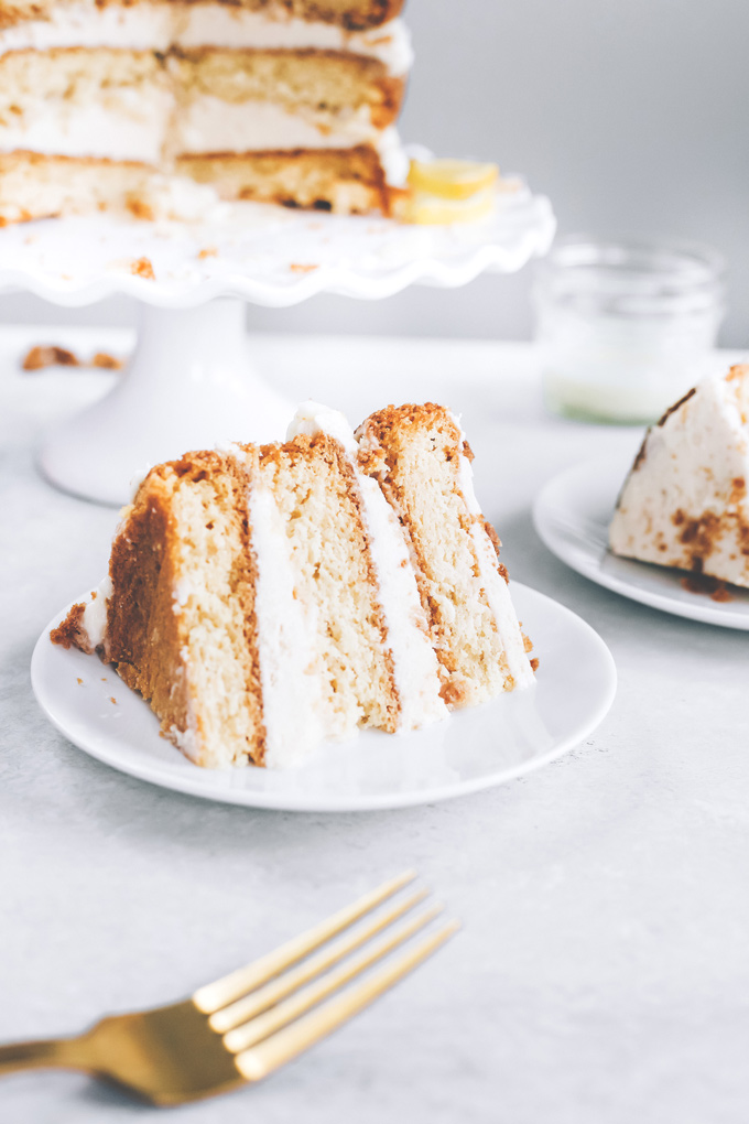 This spectacular Vegan Lemon Cream Layer Cakeis a delectable cake for the most special of occasions. Enjoy the creamy lemon buttercream sandwiched between layers of homemade vanilla cake. NeuroticMommy.com #vegan #cake #easter