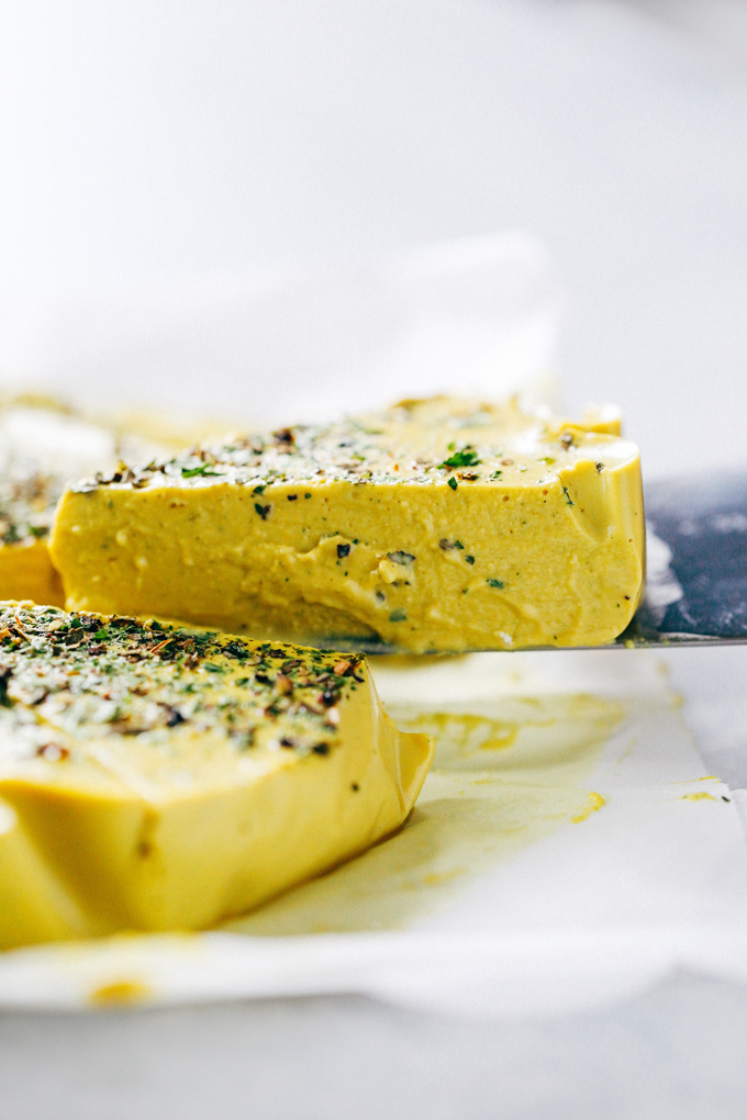 How To Make Herbed Cashew Cheese-Super cheesy texture with a salt and nutty flavor. Put this on your next vegan cheese board or serve it up on some veggie burgers for the win. Either way you're going to love it! NeuroticMommy.com #vegancheese #dairyfree