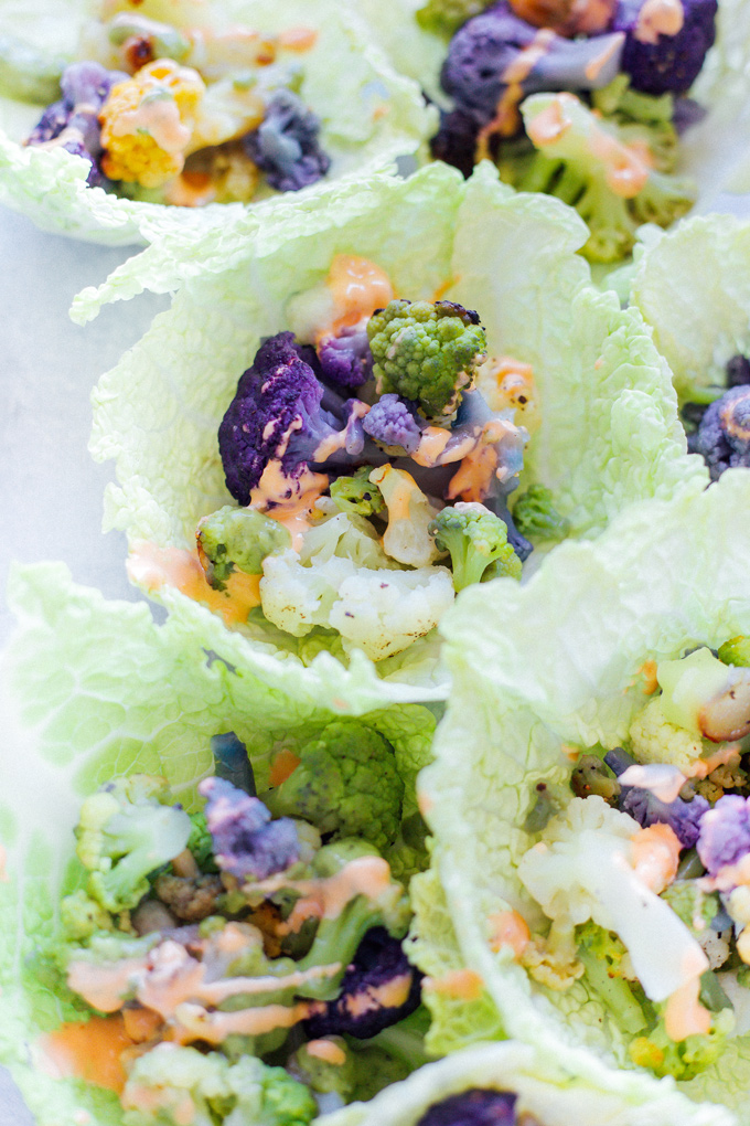 Roasted Cauliflower Cabbage Wraps - Rainbow cauliflower roasted then wrapped in savoy cabbage. Drizzle on some avocado cream or vegan thousand island dressing for added flavor. Super colorful, super delicious, super healthy. NeuroticMommy.com #cabbage #cauliflower #wraps #vegan