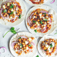 Vegan BBQ Chickpea Pizzas - BBQ coated chickpeas on top of melty vegan mozzarella cheese and loaded with so much goodness, makes this vegan pizza night a keeper! NeuroticMommy.com #veganpizza