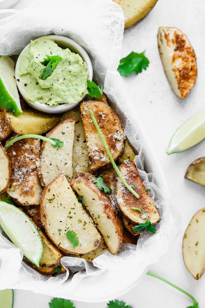 Potato Wedges with Avocado Ranch - a healthy alternative to french fries, enjoy these baked and lightly salted wedges that pair perfectly with vegan avocado ranch to dip! NeuroticMommy.com #veganfries #bakedfries #avocado