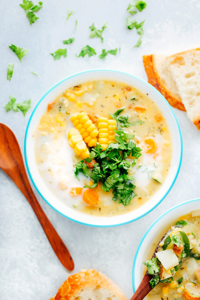 Creamy vegan chowder loaded with corn, zucchini and other herbs and veggies. This lightened up version is perfect for summer. NeuroticMommy.com #vegan