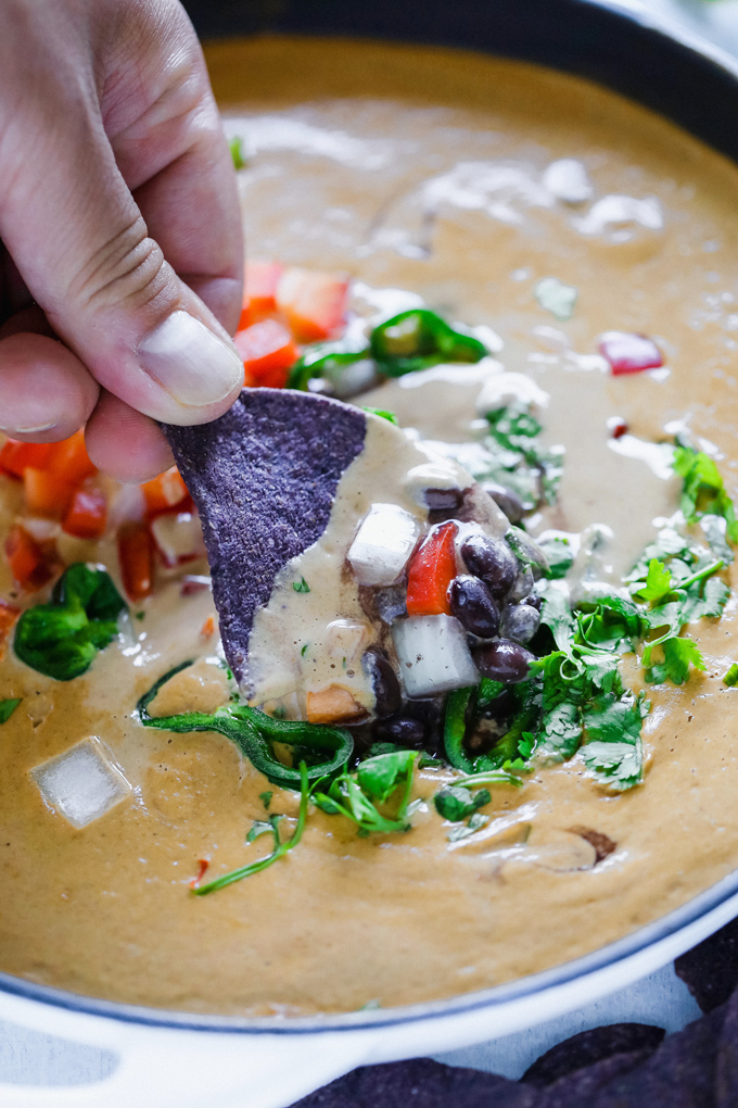 Vegan Poblano Black Bean Queso Dip is anything but basic. Loaded with all sorts of fresh goodness turned into a creamy, melty, luscious cheese dip perfect for all your dunking needs. NeuroticMommy.com #veganqueso #dip