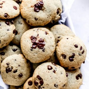 The Easiest Vegan Chocolate Chip Cookies - With a cake like center, these cookies have melty chocolate chips in every bite. No waiting for the dough to set, just whip these together with the easiest ingredients, enjoy raw or cooked and that's it! NeuroticMommy.com #vegancookies #chocolatechips #christmascookies