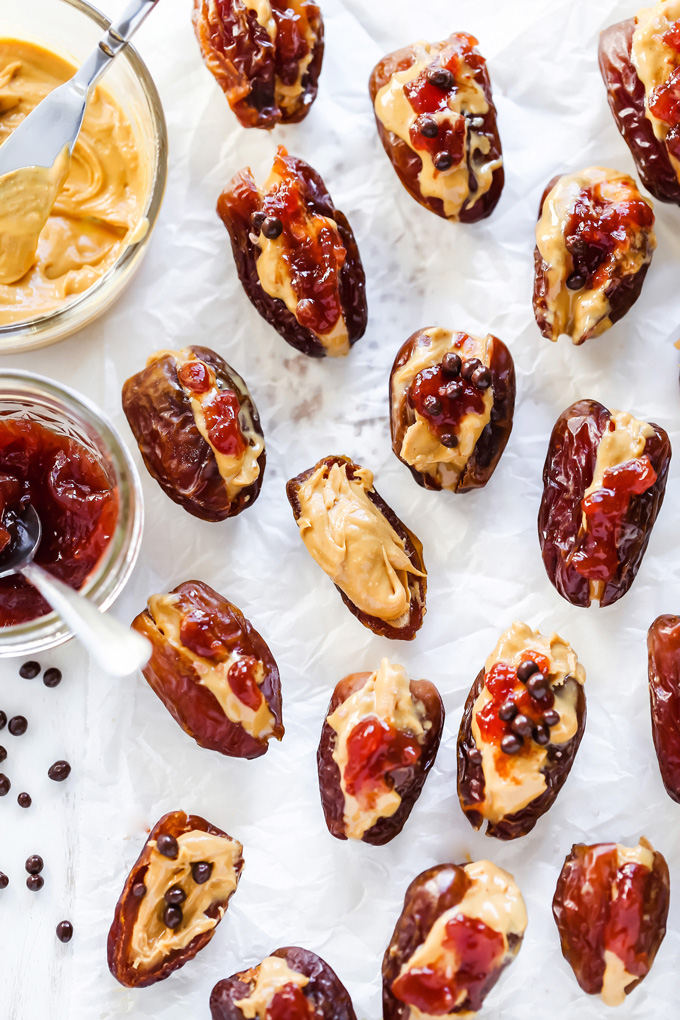 Peanut Butter and Jelly Stuffed Dates - Filled with creamy peanut butter and sweet strawberry jam, these are THE snack to have. Jam packed with goodness. NeuroticMommy.com #healthysnacks #stuffeddates