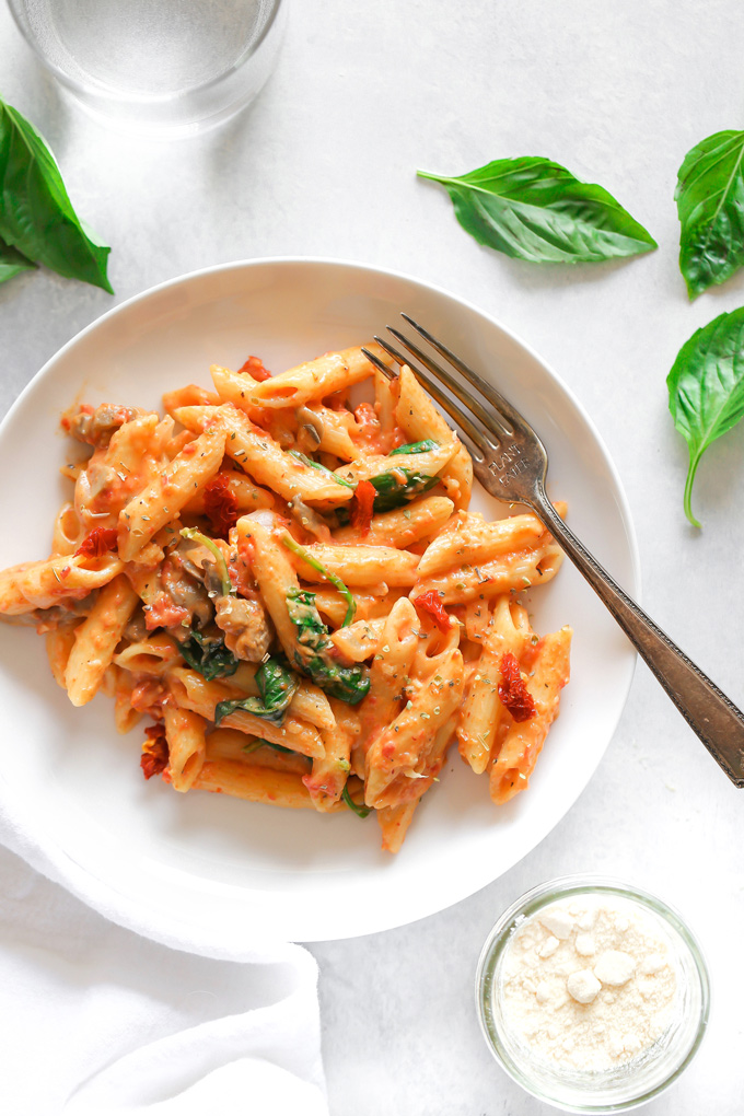 Vegan Sun-dried Tomato Basil Pasta - Just a few ingredients make up this luxuriously creamy sun-dried tomato basil cream sauce. It's perfect for dipping or swirled with your favorite pasta and veggies! - NeuroticMommy.com #vegandinner