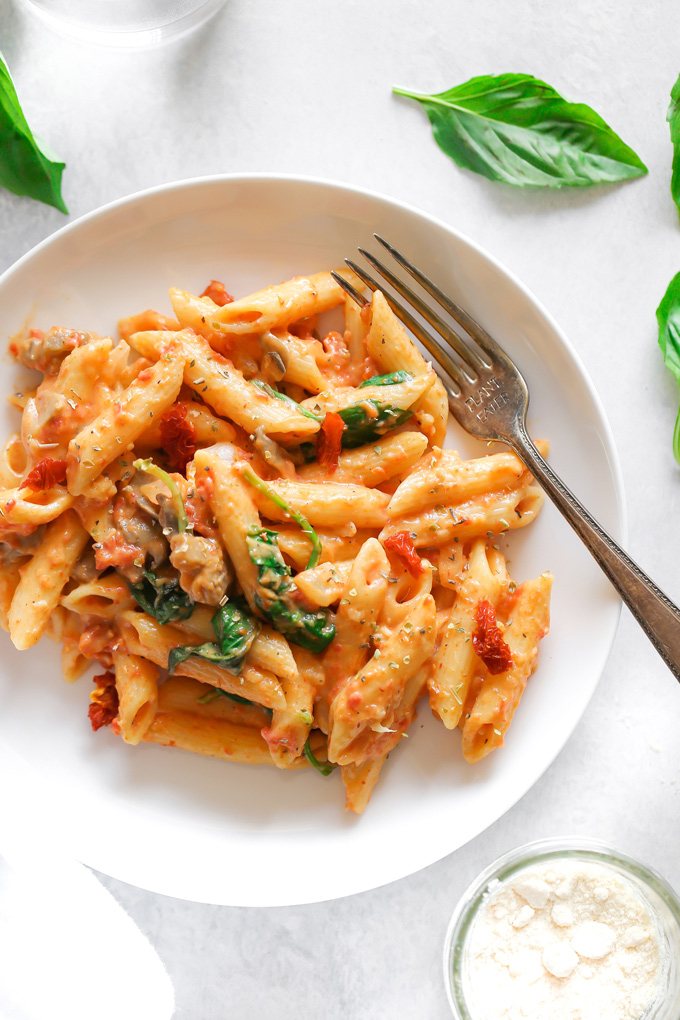 Vegan Sun-dried Tomato Basil Pasta - Just a few ingredients make up this luxuriously creamysun-dried tomato basil cream sauce. It'sperfect for dipping or swirled with your favorite pasta and veggies! - NeuroticMommy.com #vegandinner