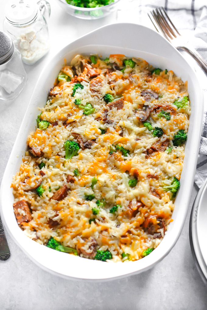 Vegan Cheesy Broccoli Sausage Rice Bake - is loaded with broccoli, rice, sausage, mushrooms and all finished off with a super melty cheesy topping. NeuroticMommy.com #vegandinner