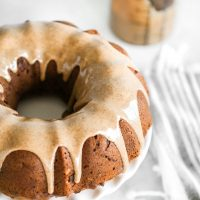Almond Butter Apple Pudding Bundt Cake tastes like pudding, it's super fluffy and light with the perfect almond butter, date, caramel drizzle, making this all sorts of delicious. And it's Vegan. NeuroticMommy.com #vegancake