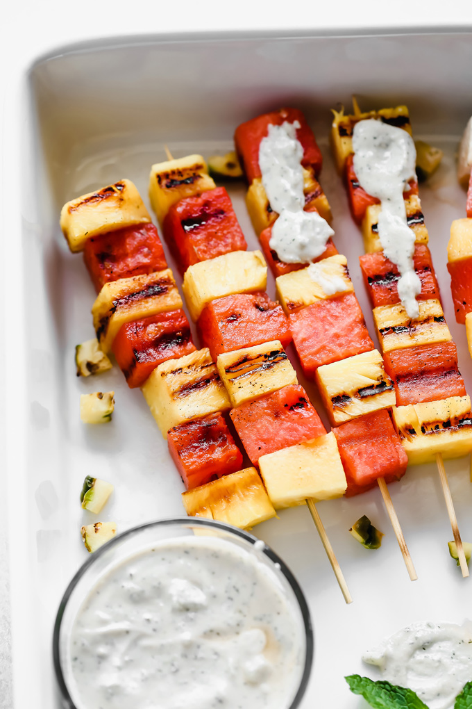Grilled Watermelon and Pineapple Skewers - Juicy and sweet pineapple and watermelon grilled to perfection then drizzled in a refreshing Vegan Tzatziki sauce bringing you all the tropical, summer feels. NeuroticMommy.com #vegan #summersnacks