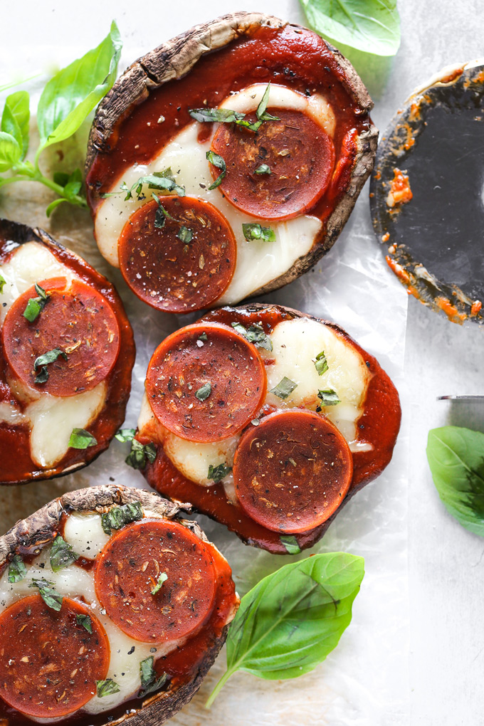 Vegan Keto Portobello Mushroom Pizzas are stuffed with vegan mozzarella, a keto friendly marinara sauce thats sugar free and topped with vegan pepperoni and sprinkles of basil. Perfect for your keto meals and hits the spot with pizza cravings! NeuroticMommy.com #keto #vegan