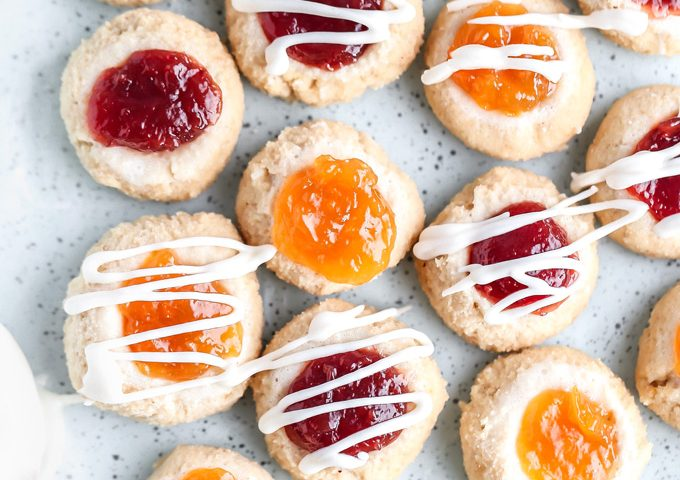 PB&J Thumbprint Cookies - Easy no bake vegan cookies are peanut buttery & filled with jam then topped with a heavenly vanilla glaze. Perfect for any occasion. NeuroticMommy.com #vegan #keto
